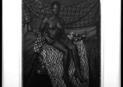 Mickalene Thomas, Portrait of Marie Sitting in Black and White, 2012, photogravure with chine collé on wove paper will full margins, 21 x 17 inches: image, 27 x 22 inches: paper, Edition of 20