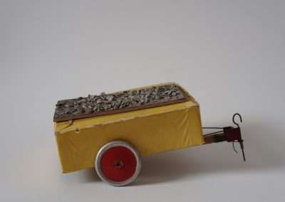 Mick Burson, Yellow Trailer, 2019 cardboard, metal, gravel, 3 x 6 x 4 inches