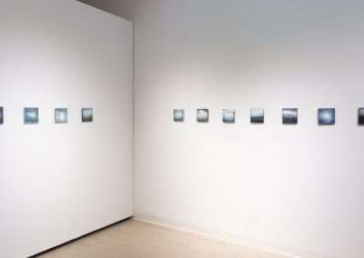 Shoshannah White, installation of 11 photographs from the series Svalbard, Iceberg, 2015/2017, photographic prints with encaustic wax, oil paint, metal dusts, gold and silver leaf, 6 x 6 inches each, individual images listed in lookbook