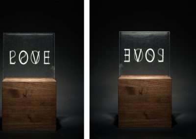 Joanne Lefrak, Love/Loss, 2018, glass, wood base, 13.5 x 4.25 inches